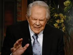 Pat Robertson, seen here praying that ugly women might be miraculously turned into hotties....