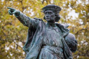 Here we see Christopher Columbus, pointing at a young girl he has chosen for his men to rape after ordering her father's murder.