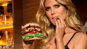 Heidi Klum, posing next to her weekly calorie intake.
