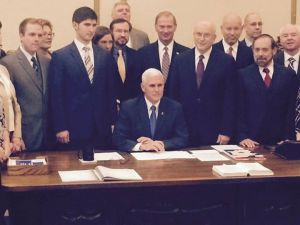 "If you're wondering who that guy standing behind Gov. Pence at the signing of the RFRA, his name is Eric Miller. He is the head of the state's latest anti-LGBT organization called ""Advance America."" They must have used their religious liberty to keep all the black folks out of the room...."